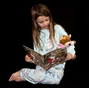 Love | Young girl reading to teddy