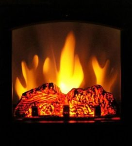 Self-care resource | A roaring fire, golden flames glowing in a dark room