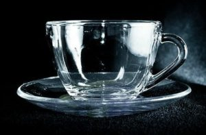 Selfish | An empty glass teacup and saucer