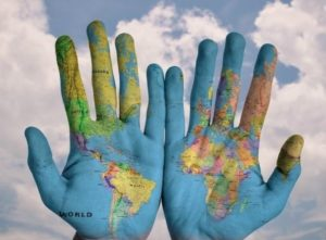 Self-care resource | A map of the world, painted onto the palms of a pair of hands