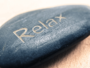 "Reiki for pain | Pebble with the word ""relax"""